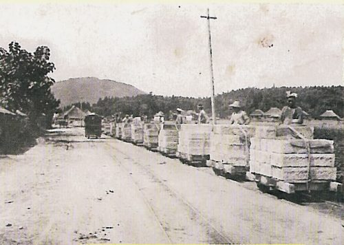 The Oya Highway in the 1910s and 20s. Passenger car pushed by men near Takaragi (Tagesan Mountain in the far back, car approaching from the back)